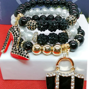 Classic Black and White Bracelet with Charms